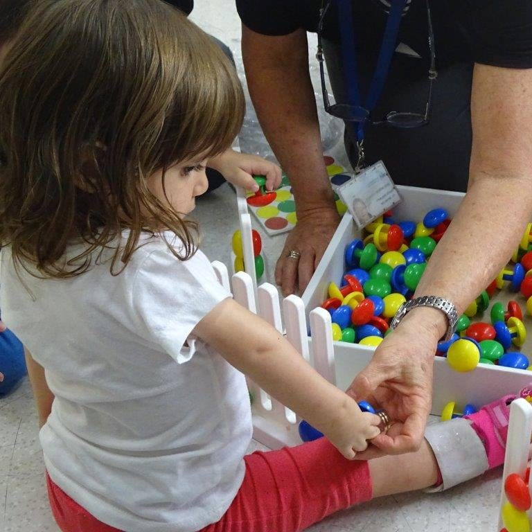 Toddler Girl Going Through Physical Therapy